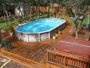 Above ground pool ideas with landscaping area