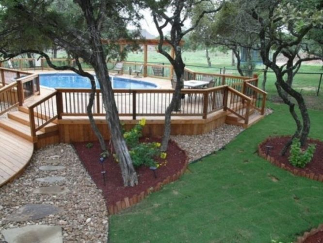 10 amazing above ground pool ideas and design for Landscaping ideas for pool areas
