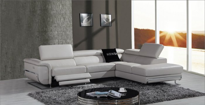 Bound leather sectional sofa with recliners