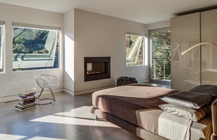 Exquisite master bedroom with a sleek fireplace