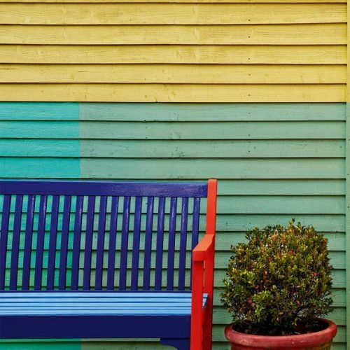 Garden fence ideas with colorful furniture