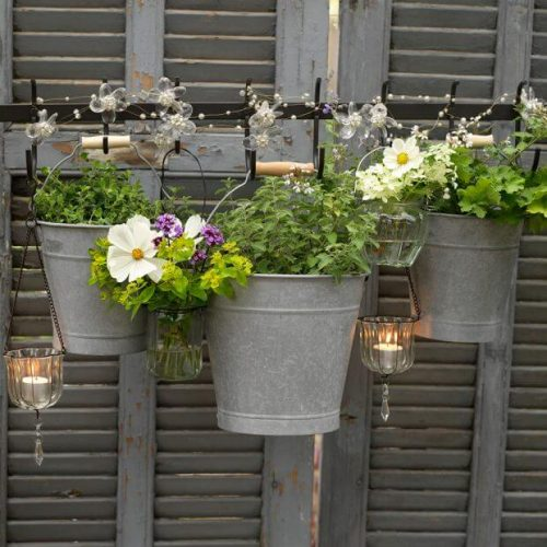 Garden fence ideas made from painted shutters