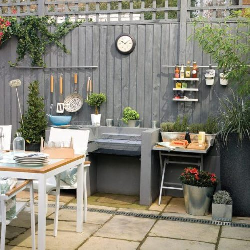 Garden fence ideas with grey painted and a cooking station