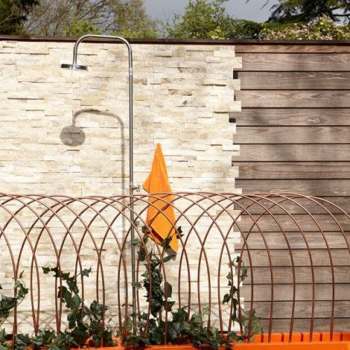 Garden fence ideas with stoned wall and stylish shower area