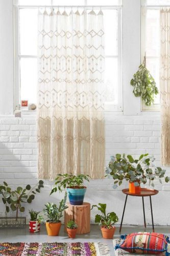Macrame wall surface hanging versus a white brick wall