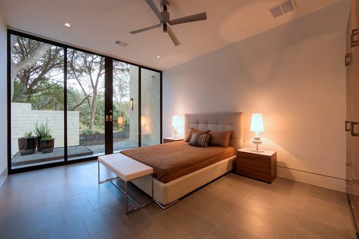 Minimal bedroom exudes inviting warm hues