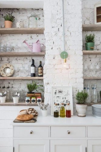 Rustic eclectic kitchen with a white brick wall