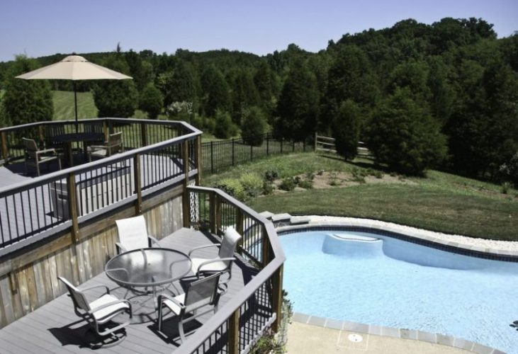 Two level deck overlooking a pool