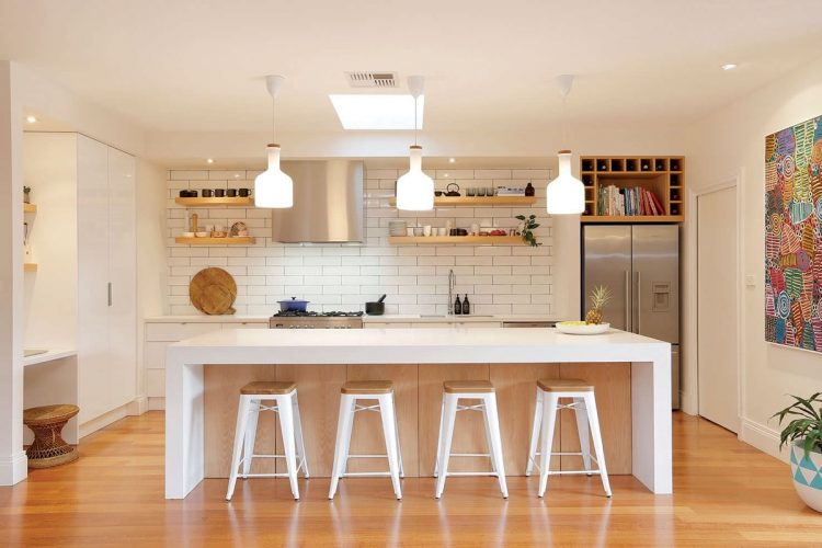 White brick kitchen with warm maple floors