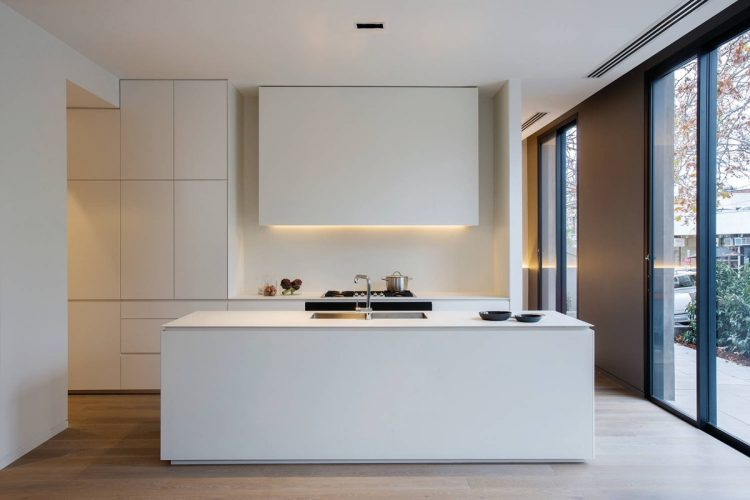 White kitchen with large window
