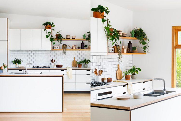 Modern white kitchen with light wood floor