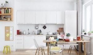 White soho kitchen light wood floors