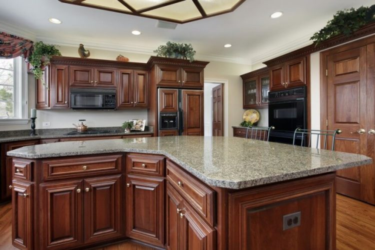 Kitchens with black appliances and light gray granite countertops