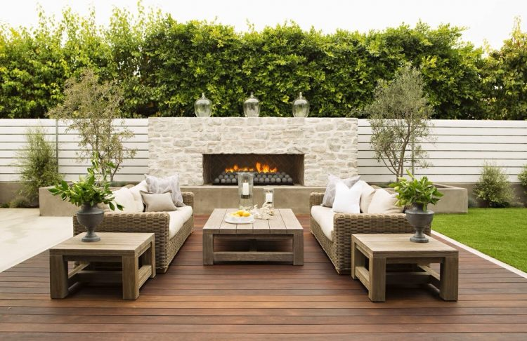 Luxe rooftop living room with fireplaces