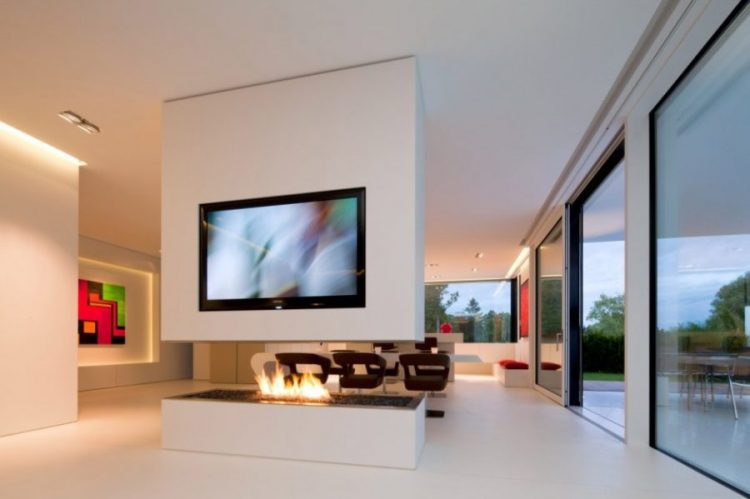 Fireplace and featuring a built-in TV stand ideas by Karl Dreer and Bembé Dellinger Architects