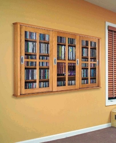 Wall mounted sliding door DVD storage ideas