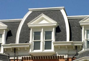 Mansard roof with pedimented, through-the-cornice dormer