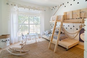 Bright white walls and custom made beds. The perfect spot for little ones to play and dream.