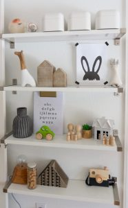 Wood accent pieces on floating shelves.