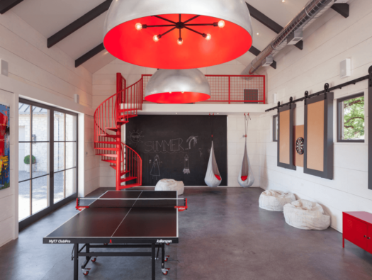 A ping pong table and gaming console make this the ultimate hangout space